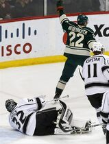 Minnesota Wild's Nino Niederreiter (22), of Switzerland, skates away while celebrating a goal off Los Angeles Kings goalie Jonathan Quick, left, in the first period of an NHL hockey game, Saturday, March 28, 2015, in St. Paul, Minn. (AP Photo/Jim Mone)