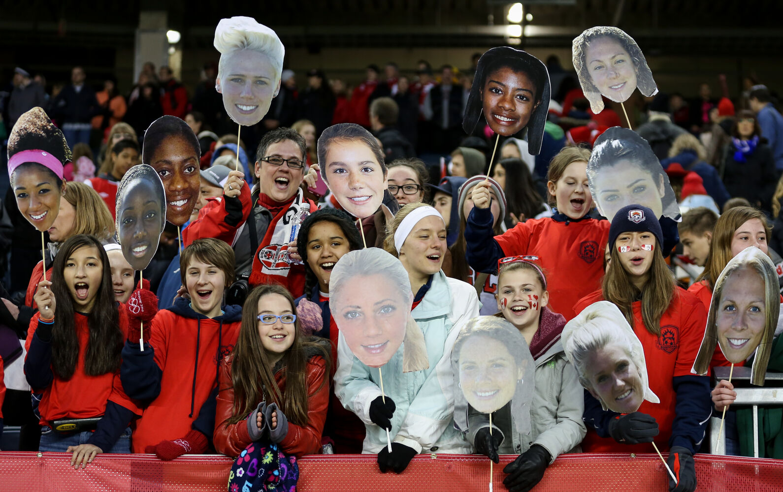 After the match fans show off their home made Team Canada signs with the faces of the players. (Melissa Tait / Winnipeg Free Press)