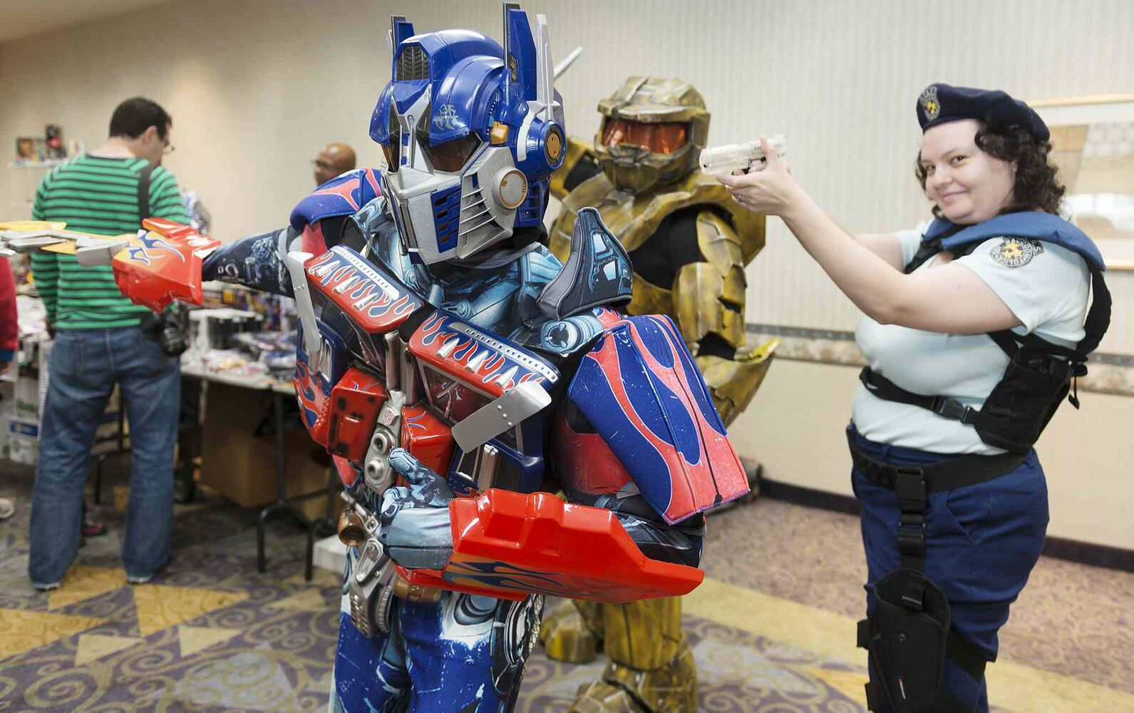 Gregory Marrast with Higher Functions Productions dresses up as Optimus Prime along with James Antoine as Griff from Halo Red vs. Blue and Sheila Breer as Jill Valentine from Resident Evil on Saturday at the Transformers Convention at the Clarion Hotel. (Sarah Taylor / Winnipeg Free Press)