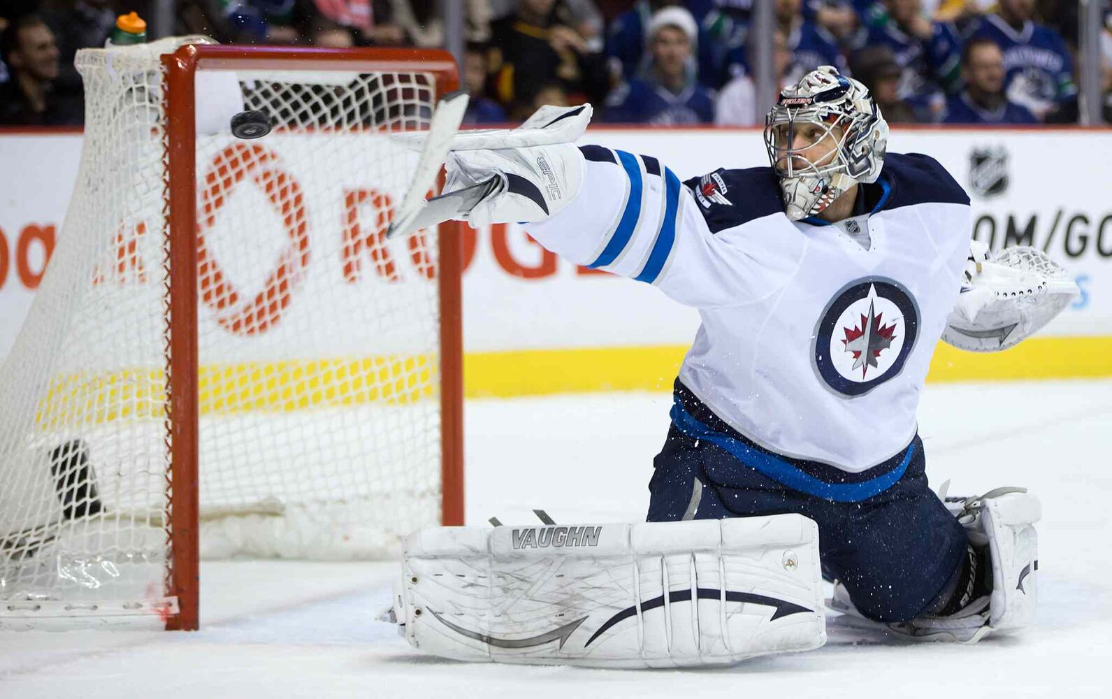 Winnipeg Jets goalie Ondrej Pavelec uses his stick to deflect a shot by Vancouver Canucks forward Ryan Kesler wide of the goal during the first period. (DARRYL DYCK / THE CANADIAN PRESS)