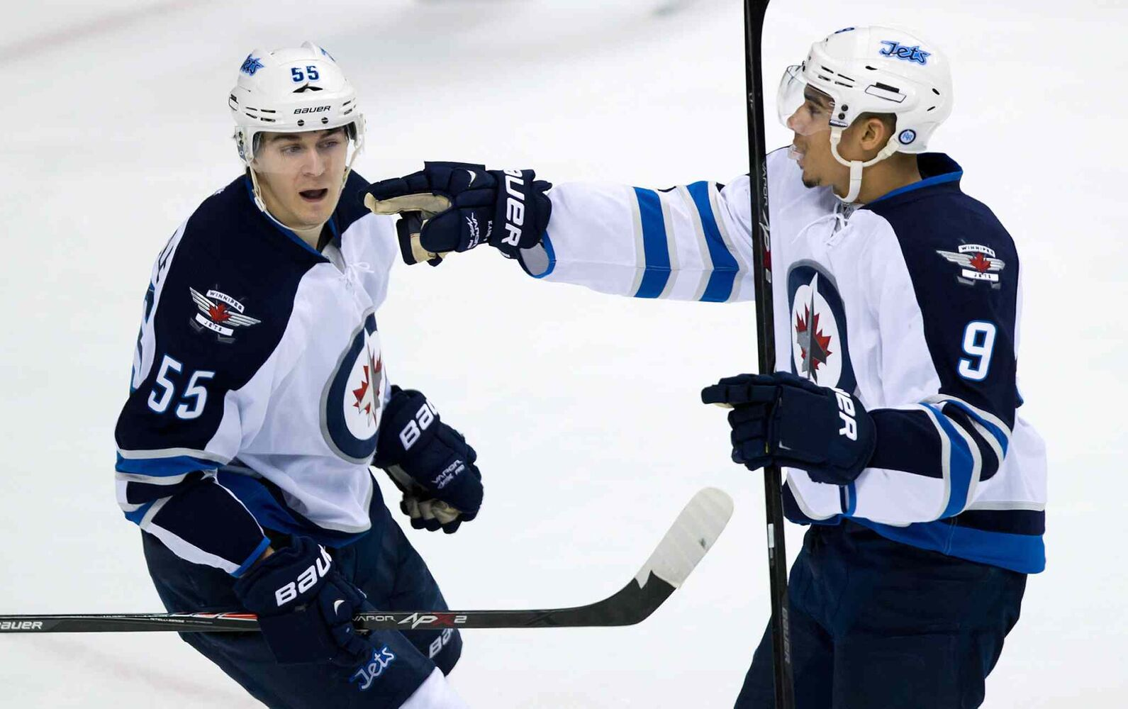 Winnipeg Jets forward Evander Kane (right) and Mark Scheifele celebrate Kane's goal against the Vancouver Canucks during the second period. (DARRYL DYCK / THE CANADIAN PRESS)