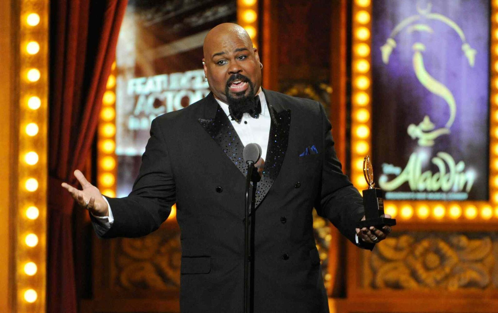 "James Monroe Iglehart accepts the award for best performance by an actor in a featured role in a musical for ""Aladdin"". (Evan Agostini / The Associated Press)"