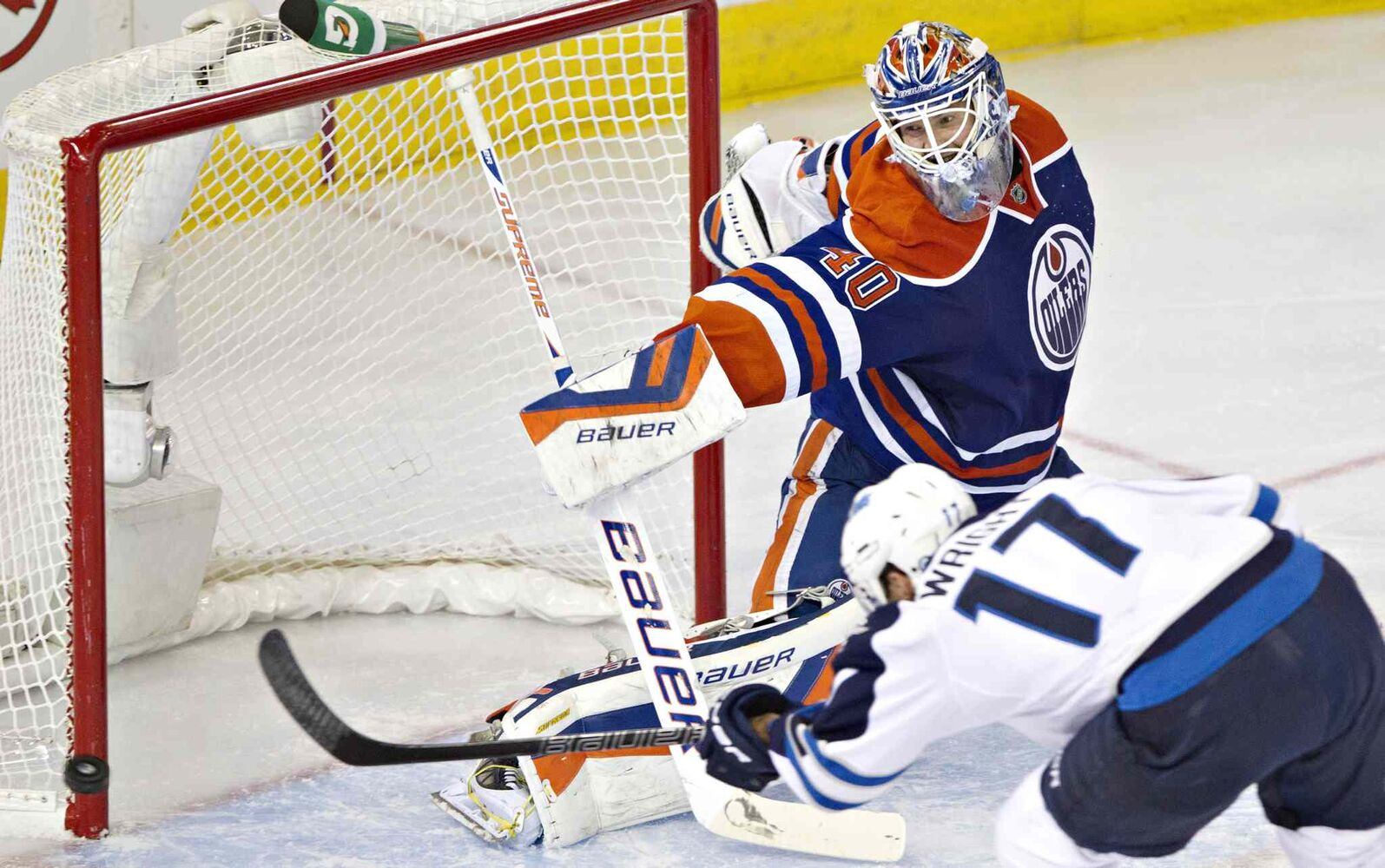 Winnipeg Jets' James Wright (17) hits the post as Edmonton Oilers goalie Devan Dubnyk (40) looks on during second period NHL hockey action in Edmonton Tuesday. (Jason Franson / The Canadian Press)