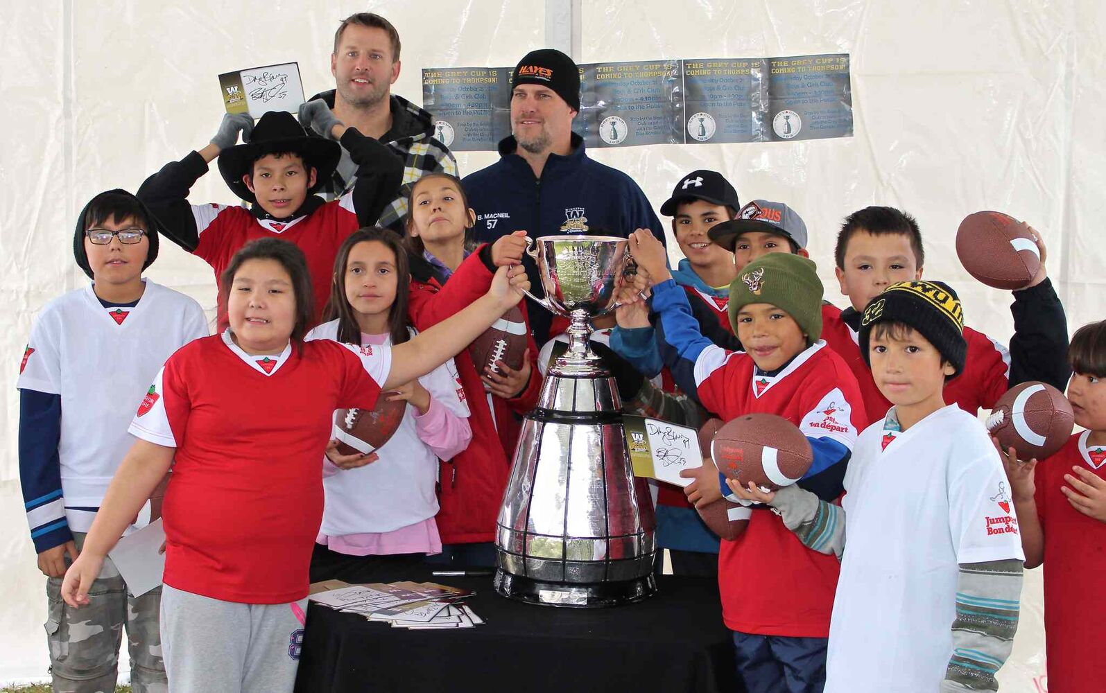The Cup stopped off at the Boys and Girls Club in Thompson. Kids got to touch the cup and pose for a picture with former Bombers Doug Brown and Brett MacNeil. (Michel LaRiviere / Travel Manitoba)