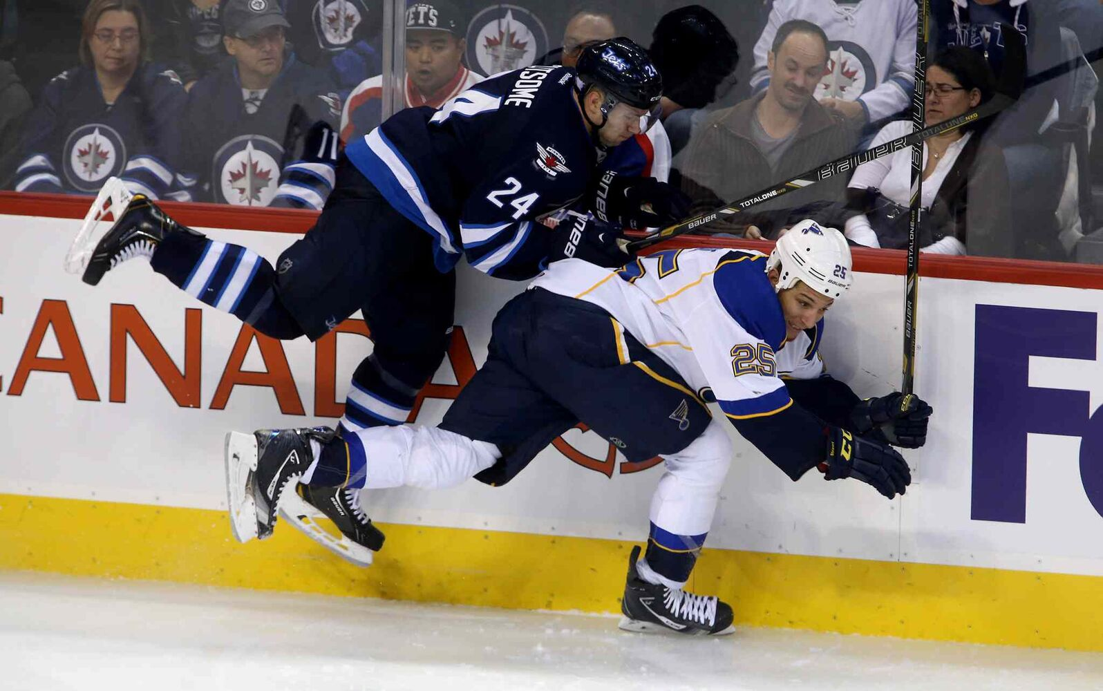 Winnipeg Jets defenceman Grant Clitsome collides with St. Louis Blues' Chris Stewart during the third period. (TREVOR HAGAN / WINNIPEG FREE PRESS)