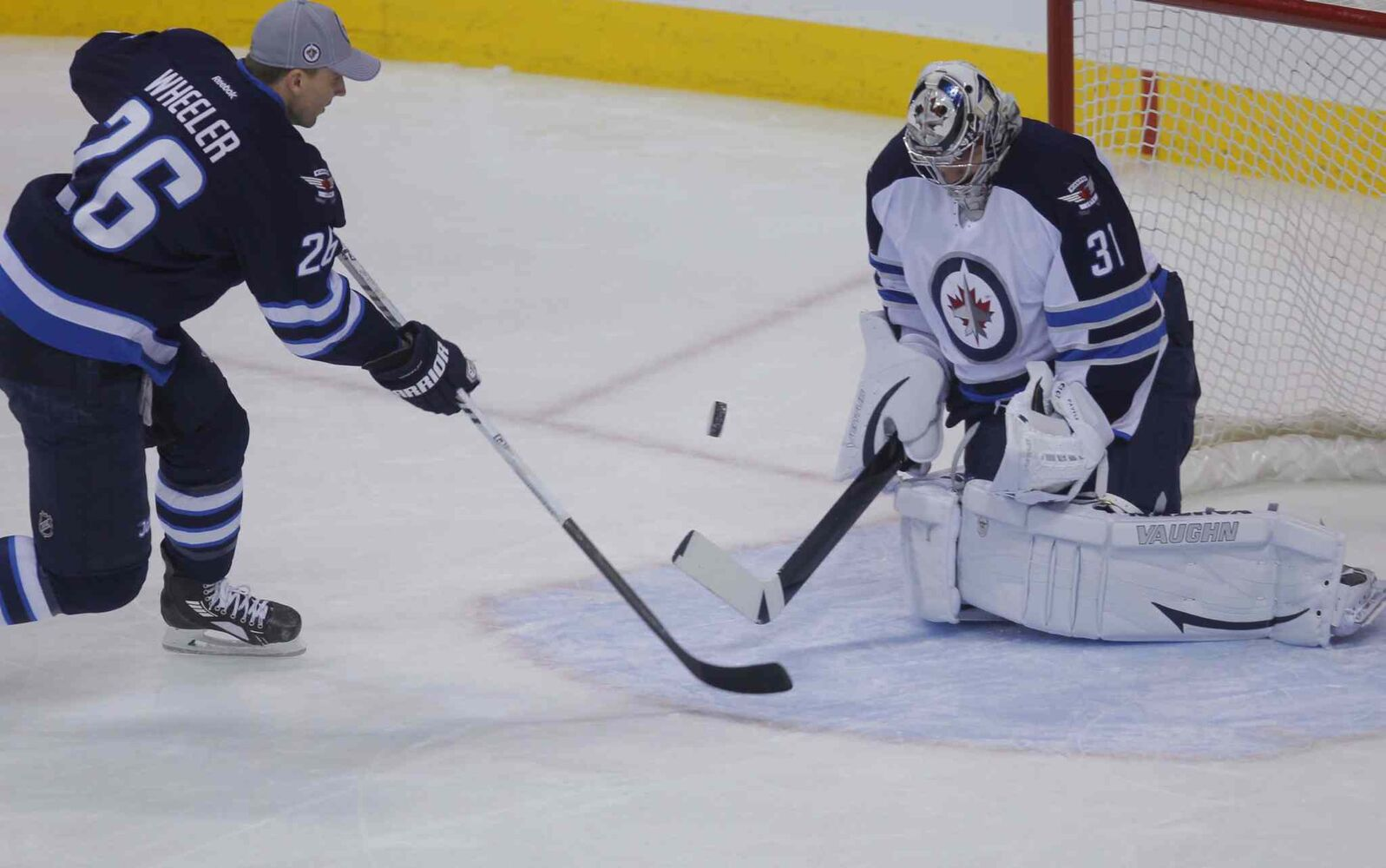 Blake Wheeler moves in on Ondrej Pavelec during the shootout portion of the skills competition.