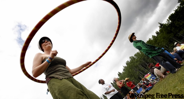 Melissa Proven and her hula hoop dance as musicians and fans continue to commune in the third of five days at the WInnipeg Folk Festival. (PHIL.HOSSACK@FREEPRESS.MB.CA )