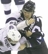 The Jets' Eric Tangradi (right) and the Lightning's Nate Thompson duke it out in the second period at the MTS Centre.