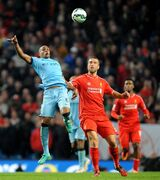 Manchester City's Fernando, left, contests the ball with Liverpool's Rickie Lambert during the English Premier League soccer match between Manchester City and Liverpool at the Etihad Stadium, in Manchester, England, Monday, Aug. 25, 2014. (AP Photo/Rui Vieira)