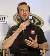 Driver Kurt Busch speaks to the media during the NASCAR Charlotte Motor Speedway media tour in Charlotte, N.C., Tuesday, Jan. 27, 2015. (AP Photo/Chuck Burton)