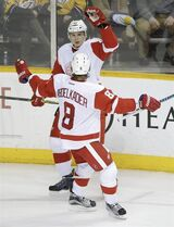 Detroit Red Wings defenseman Alexei Marchenko (47), of Russia, celebrates with Justin Abdelkader (8) after Marchenko scored a goal against the Nashville Predators in the third period of an NHL hockey game Saturday, Feb. 28, 2015, in Nashville, Tenn. (AP Photo/Mark Humphrey)
