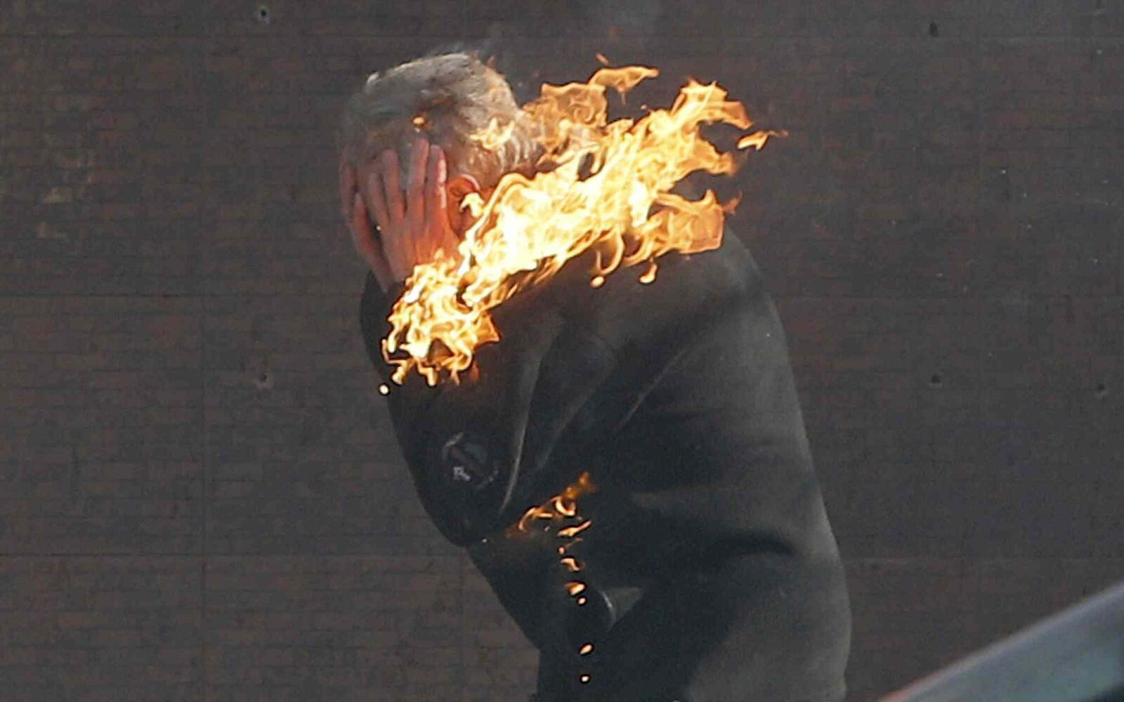 An anti-government protester is engulfed in flames during clashes with riot police outside Ukraine's parliament in Kyiv on Tuesday. (Efrem Lukatsky / The Associated Press)