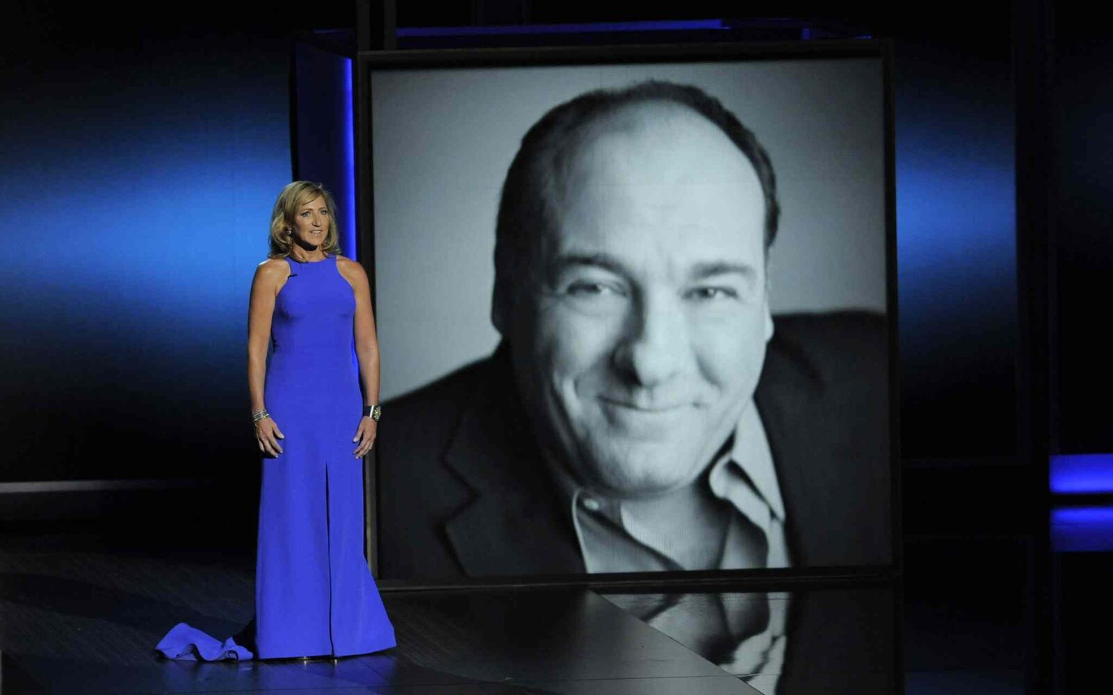 Edie Falco presents a tribute to James Gandolfini on stage. The actor, famous for his work in The Sopranos, died this year. (Chris Pizzello / The Assocaited Press)