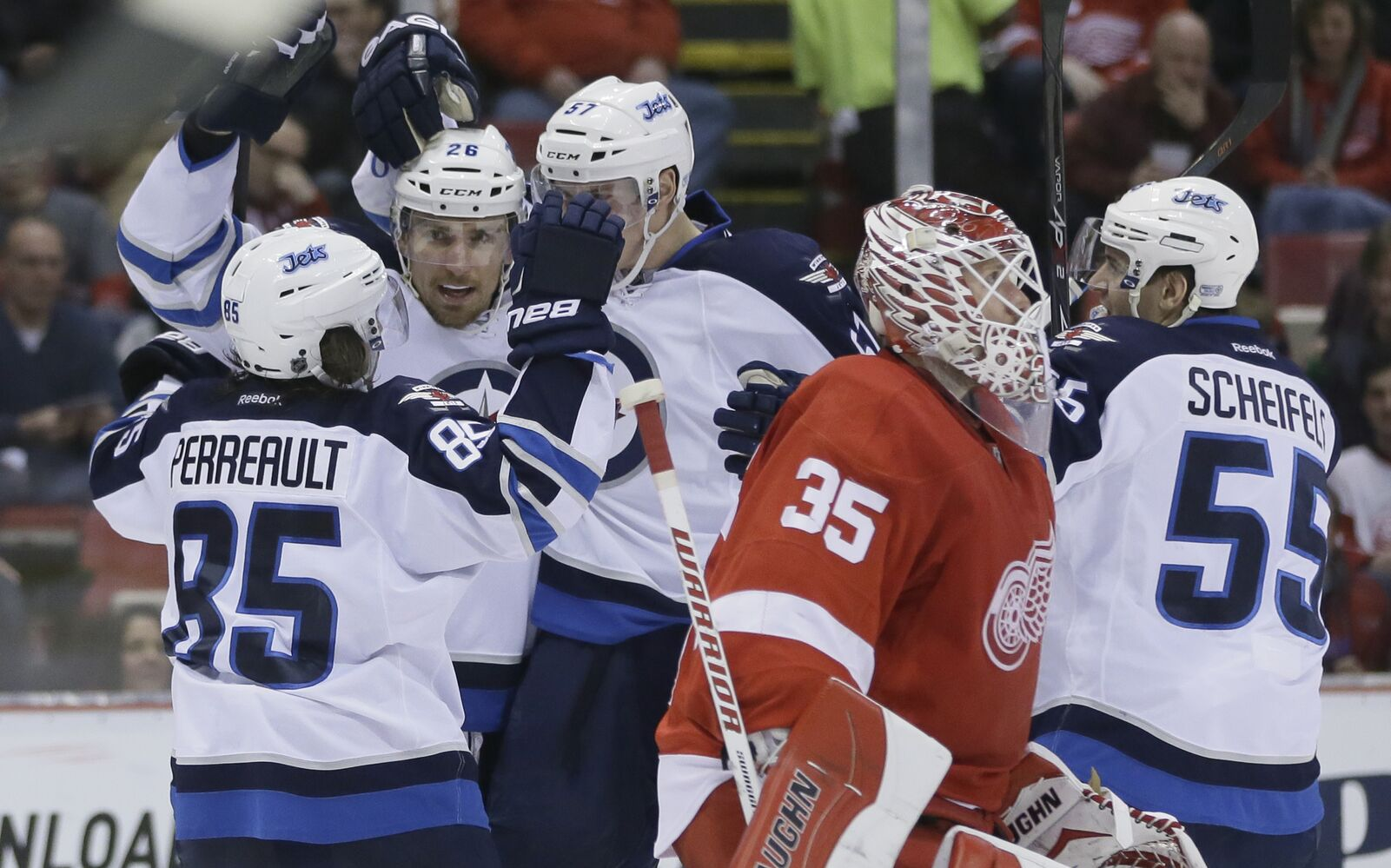 The Jets celebrate after Blake Wheeler's second-period goal. (Carlos Osorio / The Associated Press)