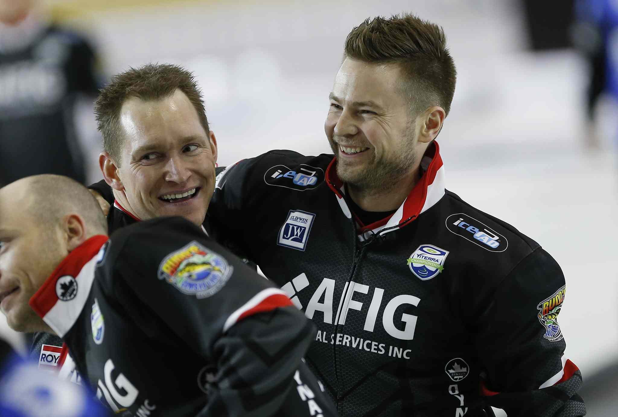 Mike McEwen (R) and Denni Neufeld celebrate after defeating Matt Dunstone at the 2016 mens provincial championships in Selkirk Sunday.