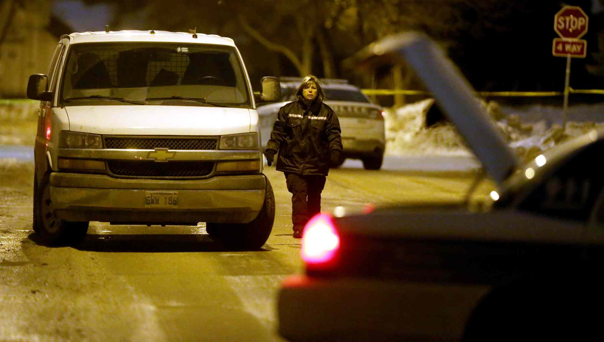Winnipeg Police and Forensic Investigators at a large crime scene on Bayne Crescent in the early morning hours of Sunday, February 21, 2016.