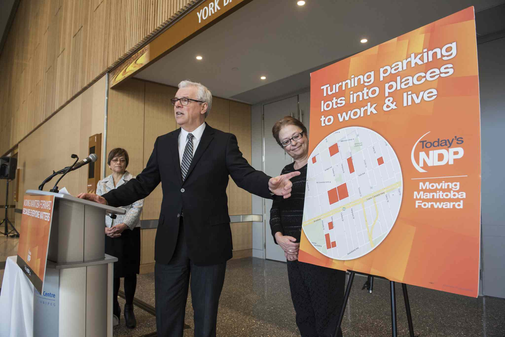 Premier and NDP Leader Greg Selinger at a news conference Tuesday, flanked by cabinet ministers Flor Marcelino (left) and Melanie Wight.