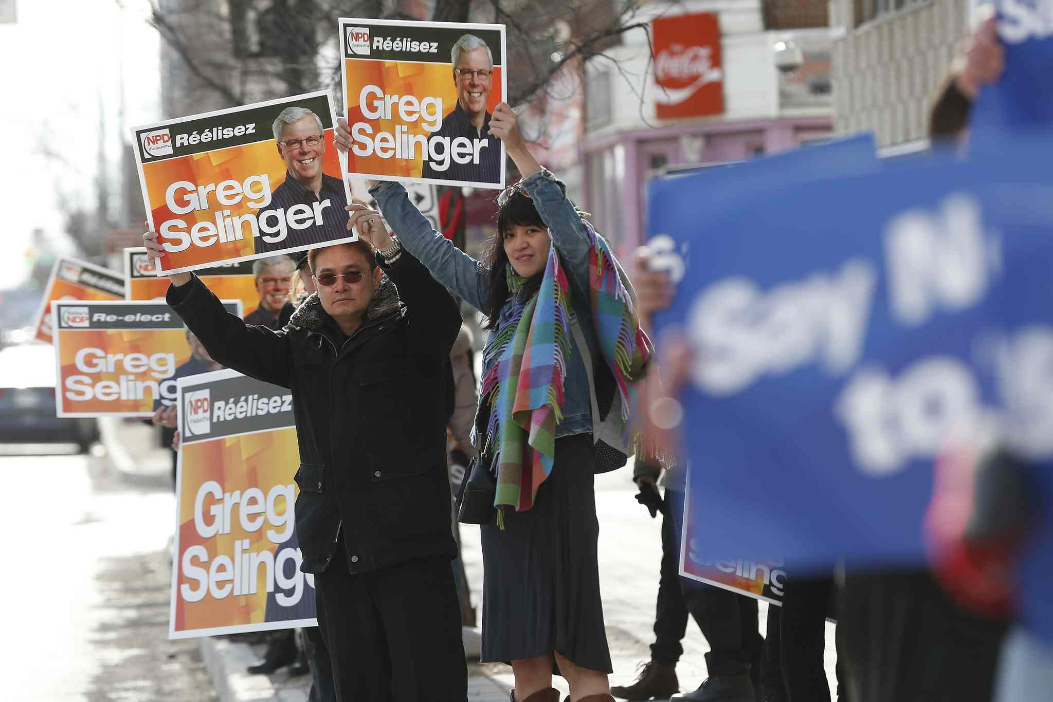 NDP and Tory supporters gather outside the venue for the televised leaders' debate.