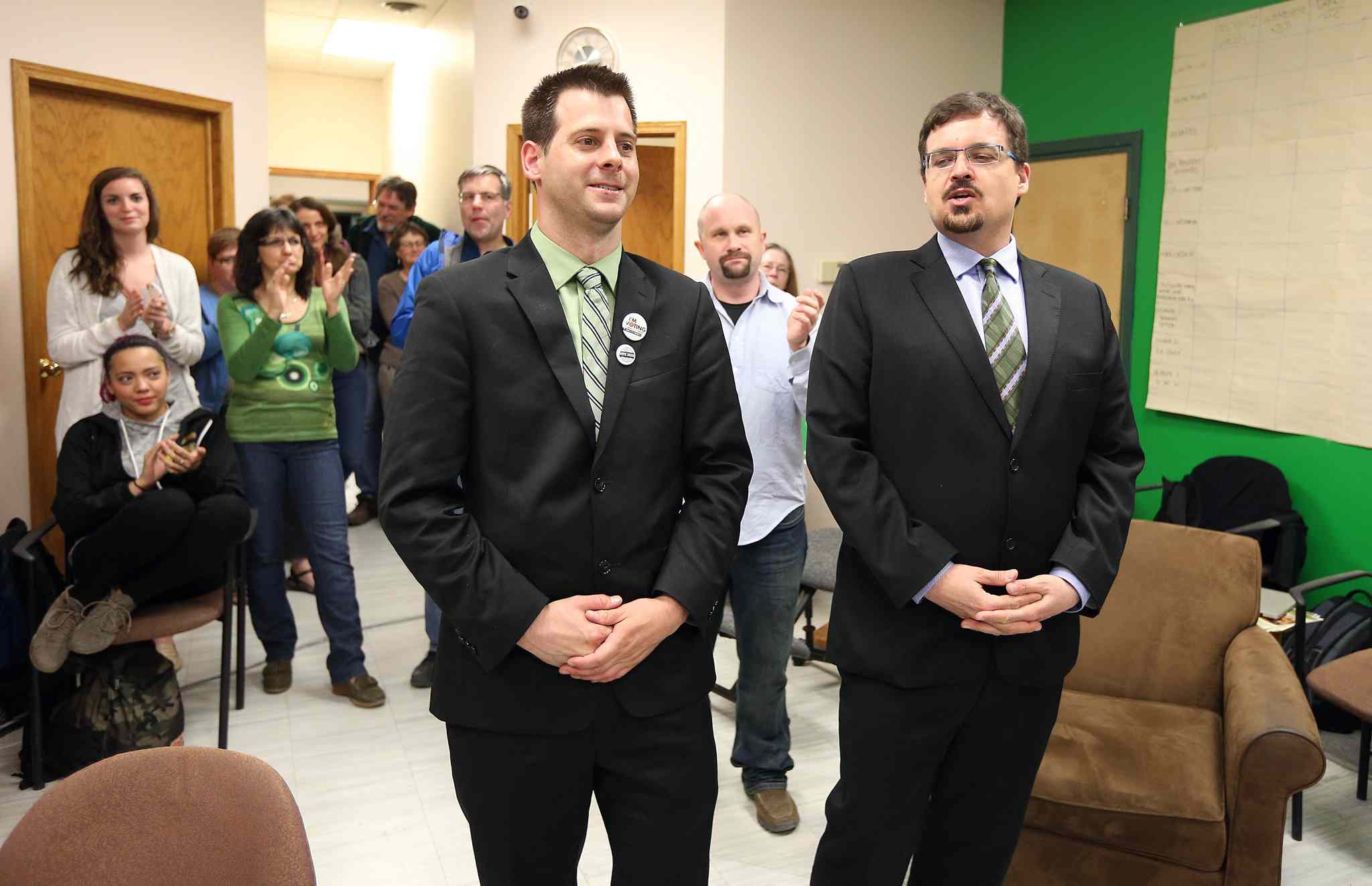 Green party candidate for Wolseley, David Nickarz (right), and Green party leader James Beddome speak to media briefly at Wolseley constituency headquarters on Portage Avenue. An official count will be held Wednesday as the race was too close to call.