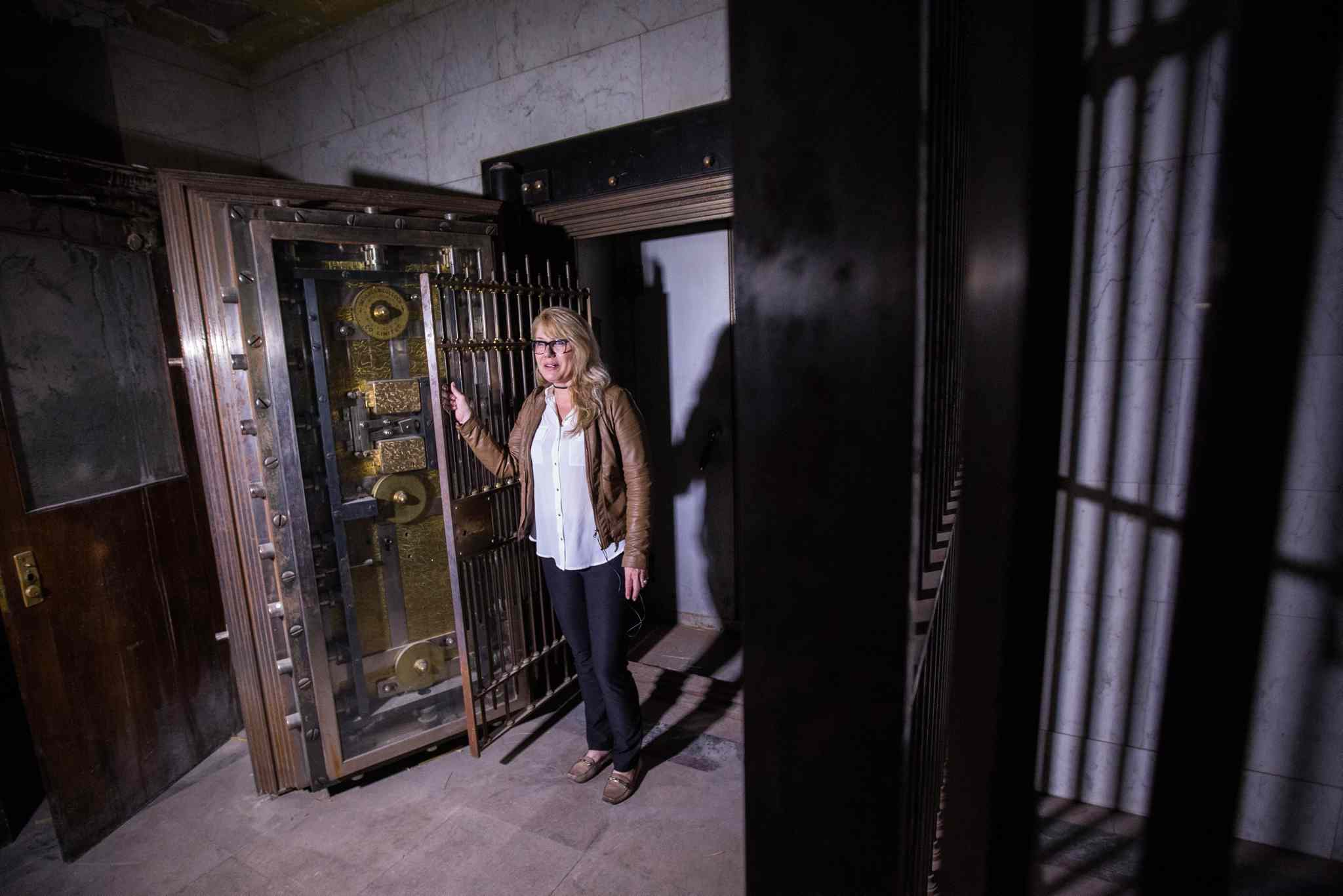 Cindy Tugwell, Executive Director for Heritage Winnipeg, in the vault in the basement of the Millennium Centre that would have held bank customers safety deposit boxes.