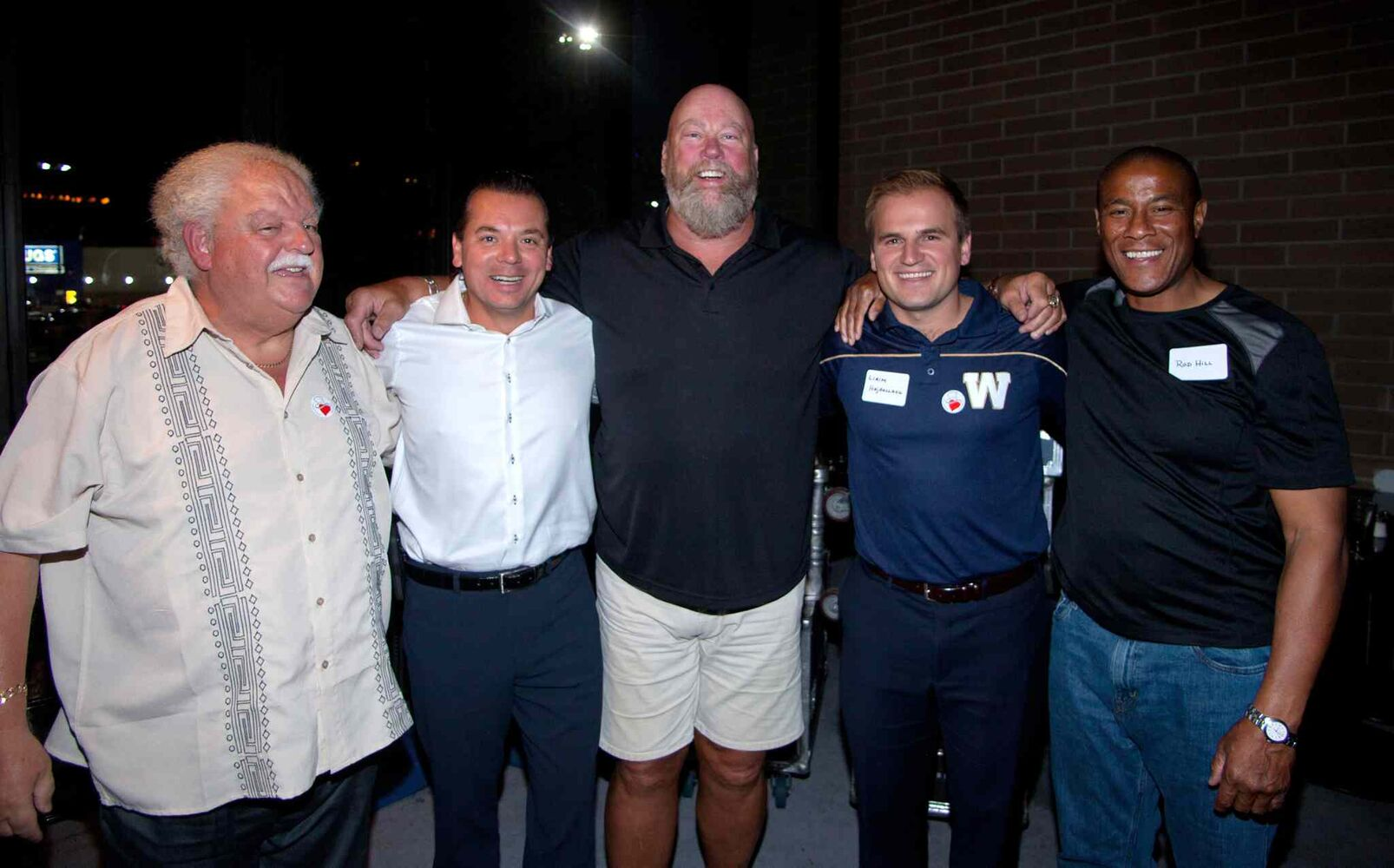 Winnipeg Blue Bombers past and present came out to support Variety, the Children's Charity of Manitoba, at Earls St. Vital on Aug. 25, 2015. The Hearts of Blue and Gold fundraising dinners are held twice a year. Pictured, from left, are Earl Barish (Salisbury House CEO) and Lenny Baranyk (Pratts Food Service CEO) with Chris Walby, Lirim Hajrullahu and Rod Hill. (JOHN JOHNSTON / WINNIPEG FREE PRESS)