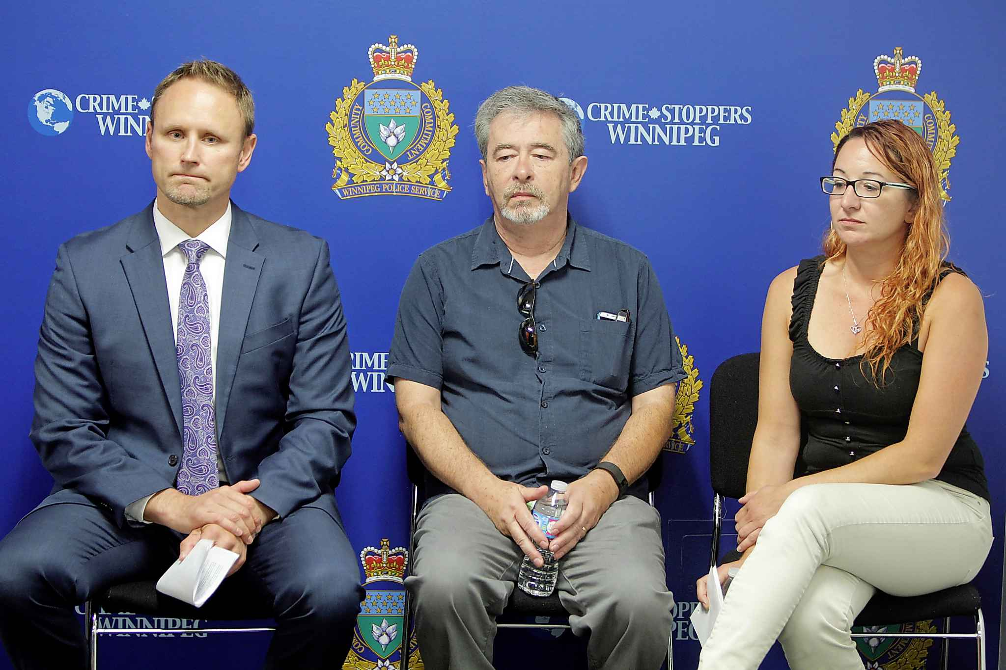 Homicide Sgt. Wes Rommel (from left), Bob Krull (Thelma's husband) and Lisa Besser (Thelma's daughter) at a press conference on the one-year anniversary of Thelma Krull's disappearance. (Boris Minkevich / Winnipeg Free Press files)