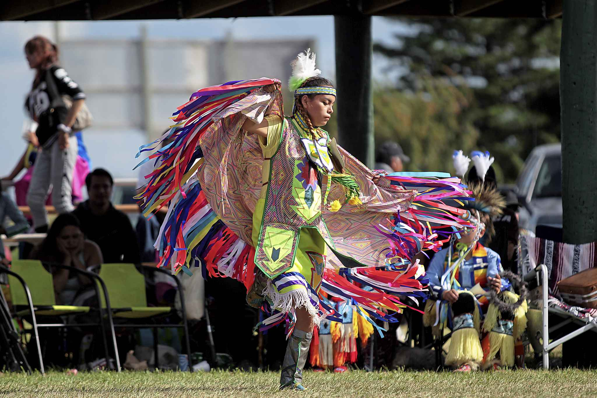 Sashawnee Kay of Kawacatoose First Nation in Saksatchewan dances in the teen girl's fancy dance category during the Rolling River First Nation powwow in 2016.