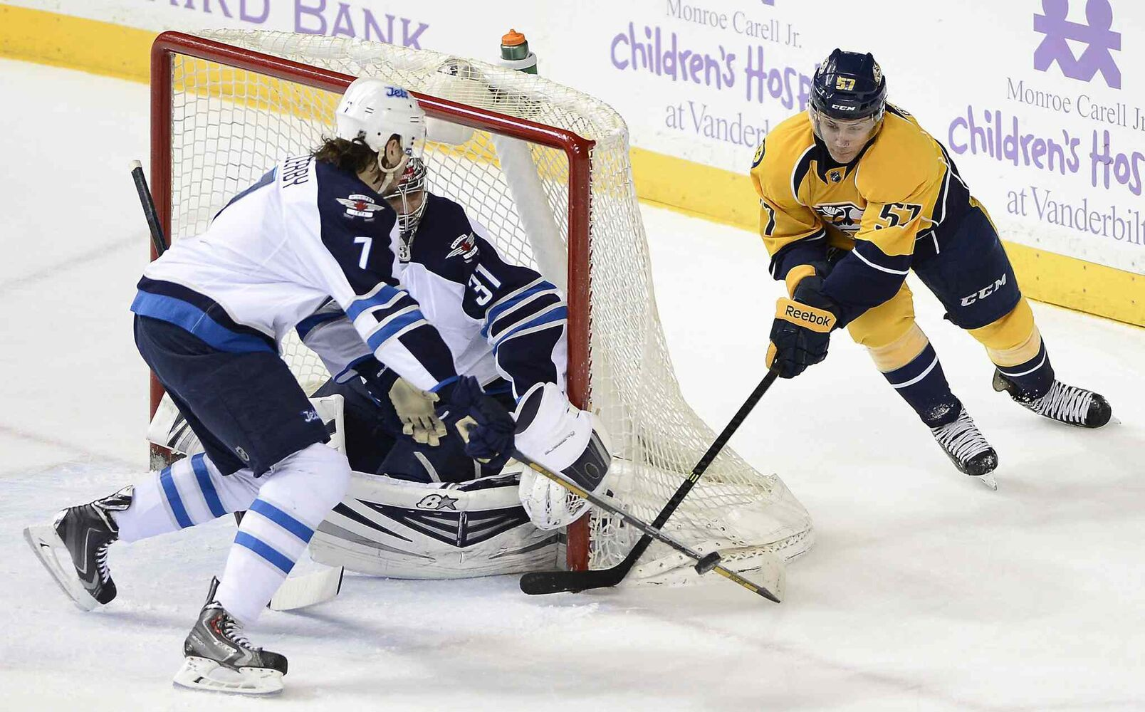 Nashville Predators forward Gabriel Bourque (57) has his first-period shot blocked by Winnipeg Jets defenseman Keaton Ellerby (7) and goalie Ondrej Pavelec (31) on Saturday. (Mark Zaleski / The Associated Press)