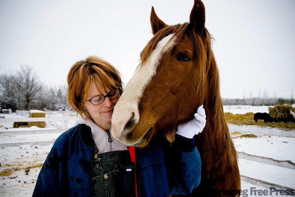Bonnie Riddell, with Rusty, one of the many horses nursed back to health at Papa's Ranch.