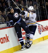 Dustin Byfuglien gets a dose of his own medicine from Buffalo Sabres' Nicolas Deslauriers Tuesday at the MTS Center in Winnipeg.