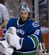 Vancouver Canucks goalie Ryan Miller (30) prepares to leave the bench following the Canucks loss to the Arizona Coyotes in Vancouver, Monday, Sept. 29, 2014. The Canucks took the boldest steps to try and keep pace in the tough Western Conference. They were forced to part with Ryan Kesler but got centre Nick Bonino as part of the Ducks deal and went on a trading/buying spree that included a new No. 1 goaltender in Miller. THE CANADIAN PRESS/Jonathan Hayward