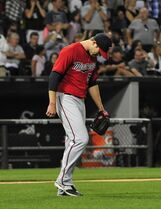Minnesota Twins relief pitcher Casey Fien looks down after the Chicago White Sox scored two runs during the eighth inning of a baseball game, Friday, Aug. 1, 2014, in Chicago. (AP Photo/David Banks)