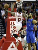 Houston Rockets' James Harden (13) goes up as Dallas Mavericks' Tyson Chandler (6) defends during the second quarter of an NBA basketball game Saturday, Nov. 22, 2014, in Houston. (AP Photo/David J. Phillip)