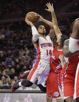 Detroit Pistons guard D.J. Augustin (14) shoots over the defense of Los Angeles Clippers guard Jordan Farmar (1) during the first half of an NBA basketball game in Auburn Hills, Mich., Wednesday, Nov. 26, 2014. (AP Photo/Carlos Osorio)