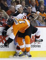 Philadelphia Flyers' Wayne Simmonds, left, collides with New Jersey Devils' Andy Greene during the second period of an NHL hockey game, Tuesday, March 11, 2014, in Philadelphia. (AP Photo/Matt Slocum)