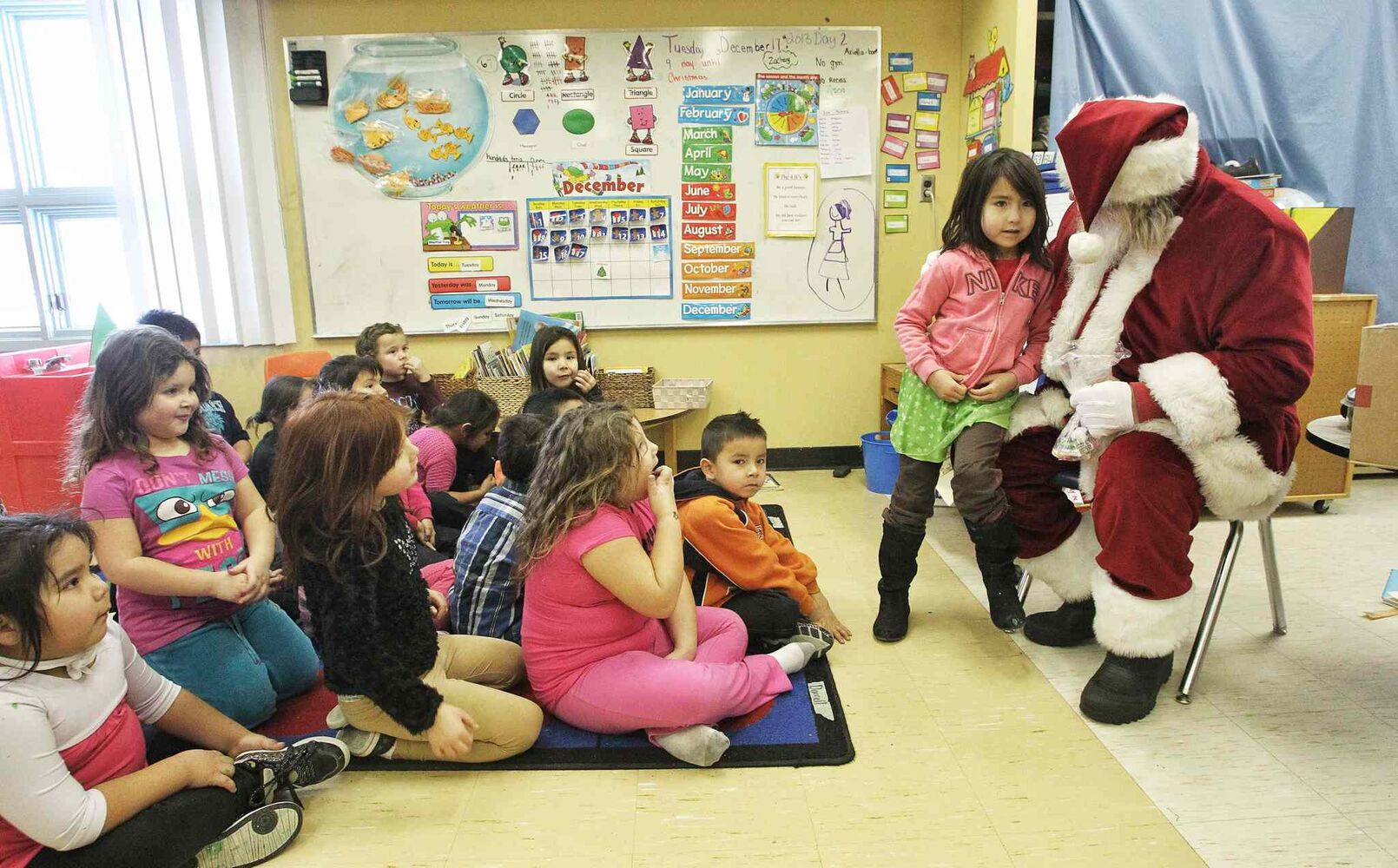 Gabriel Wilson, 5, talks to Santa as he meets with the kindergarten and Grade 1 kids at the Sergeant Tommy Prince School on the Brokenhead Ojibway First Nation during the Santa Express tour. (Mike Deal / Winnipeg Free Press)