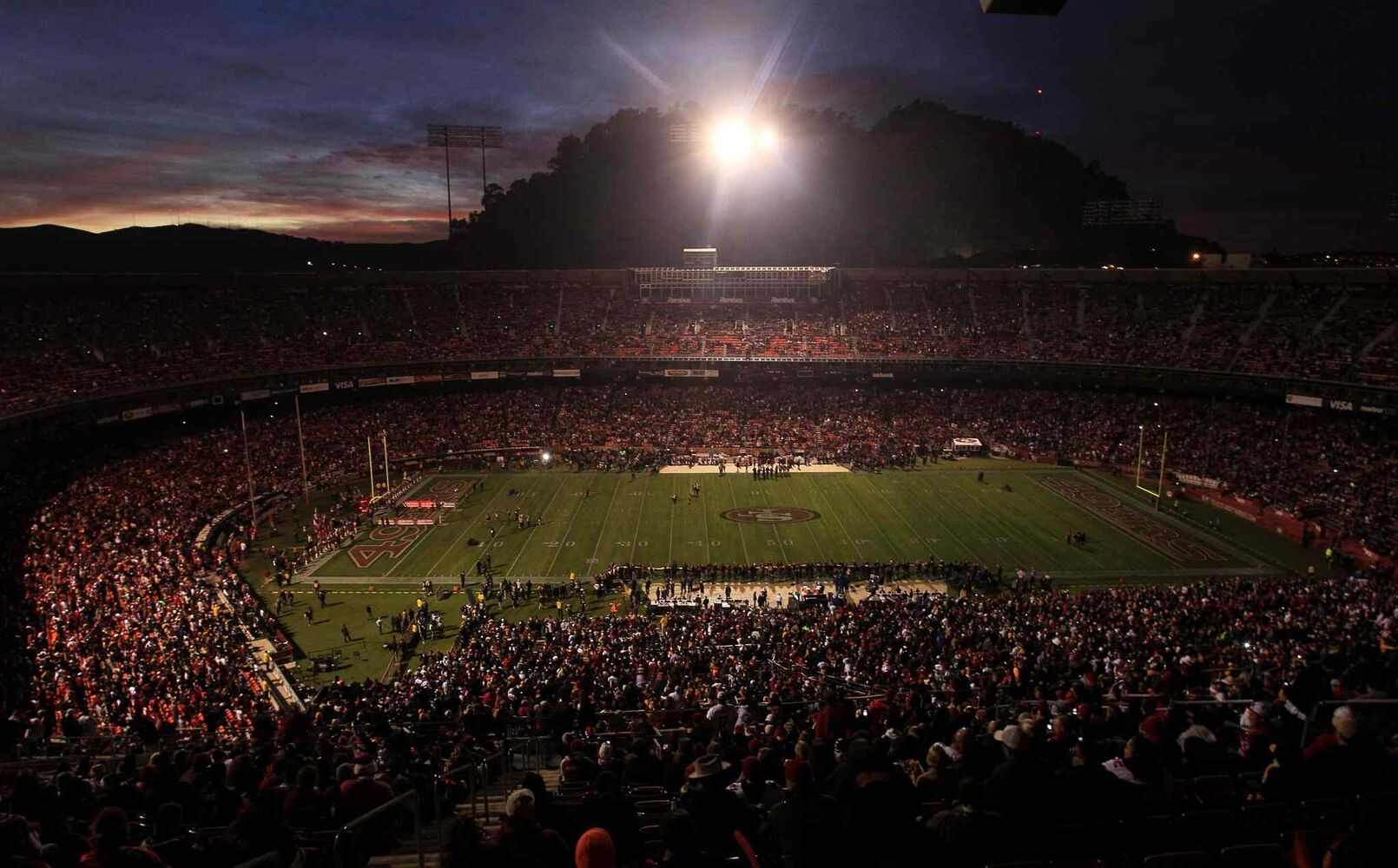 Candlestick Park is dimly lit during a power outage before an NFL football game between the San Francisco 49ers and the Pittsburgh Steelers in December 2011.