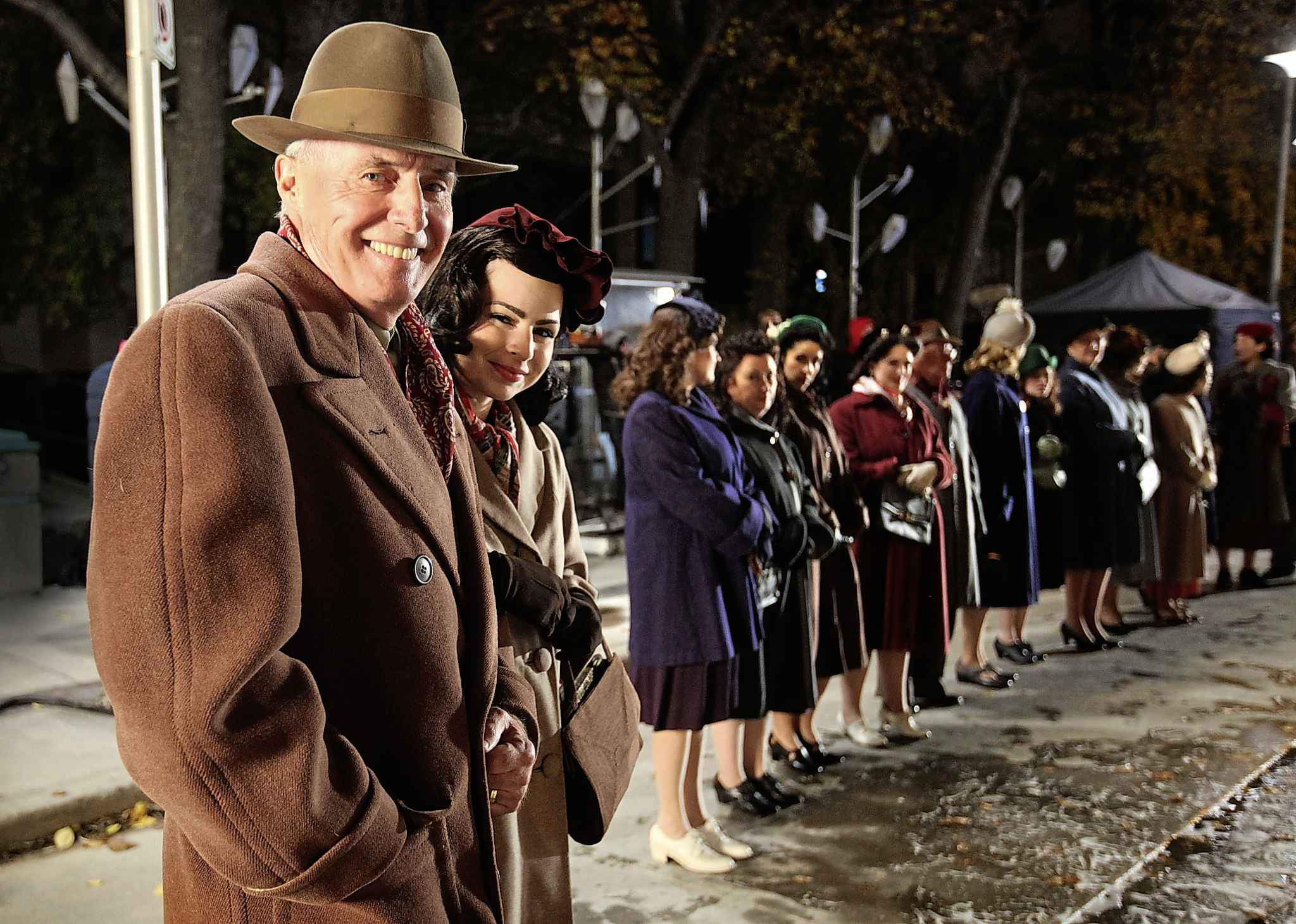 Extras dressed in wardrobe from the 1945 era stand outside Pantages Theatre in 2016 waiting for their scene in the Hallmark film Journey Back to Christmas.    RUTH BONNEVILLE / WINNIPEG FREE PRESS