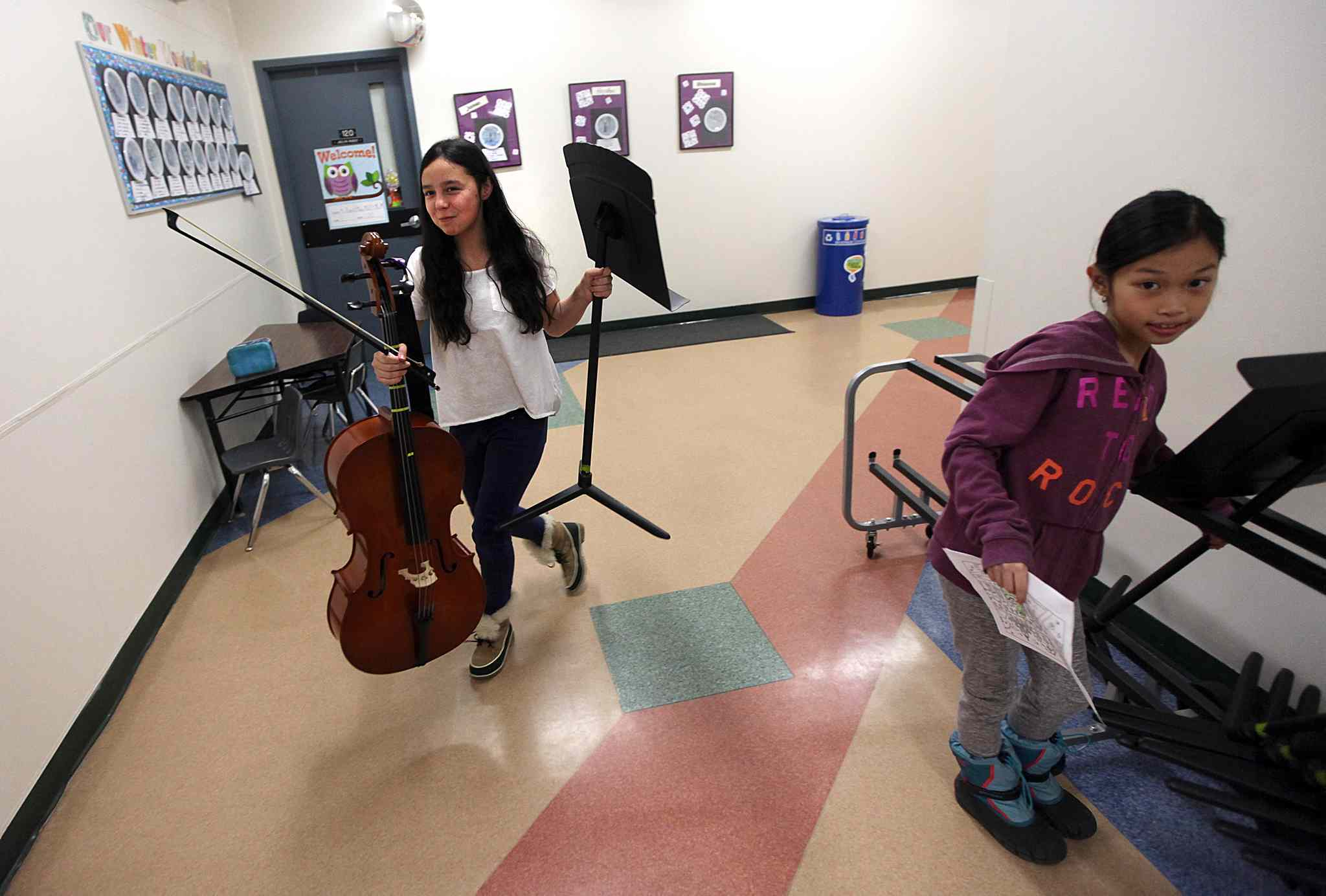 Cheyanne Sutherland, left, and Ehrica Demillo, right, head to rehearsal.