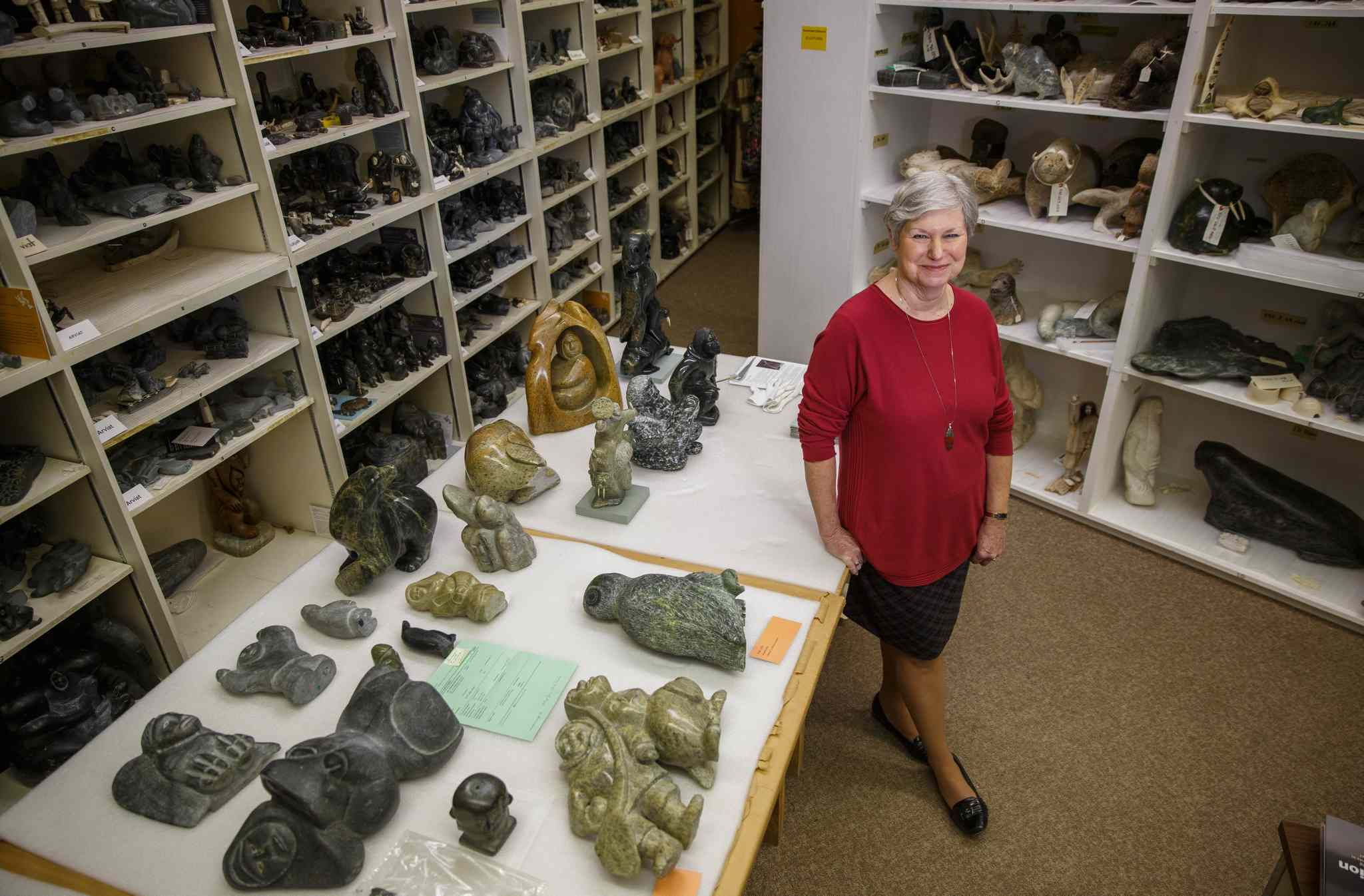 MIKE DEAL / WINNIPEG FREE PRESS</p><P> Curator Darlene Coward Wight among the WAG's 'encyclopedic collection' of Inuit art.