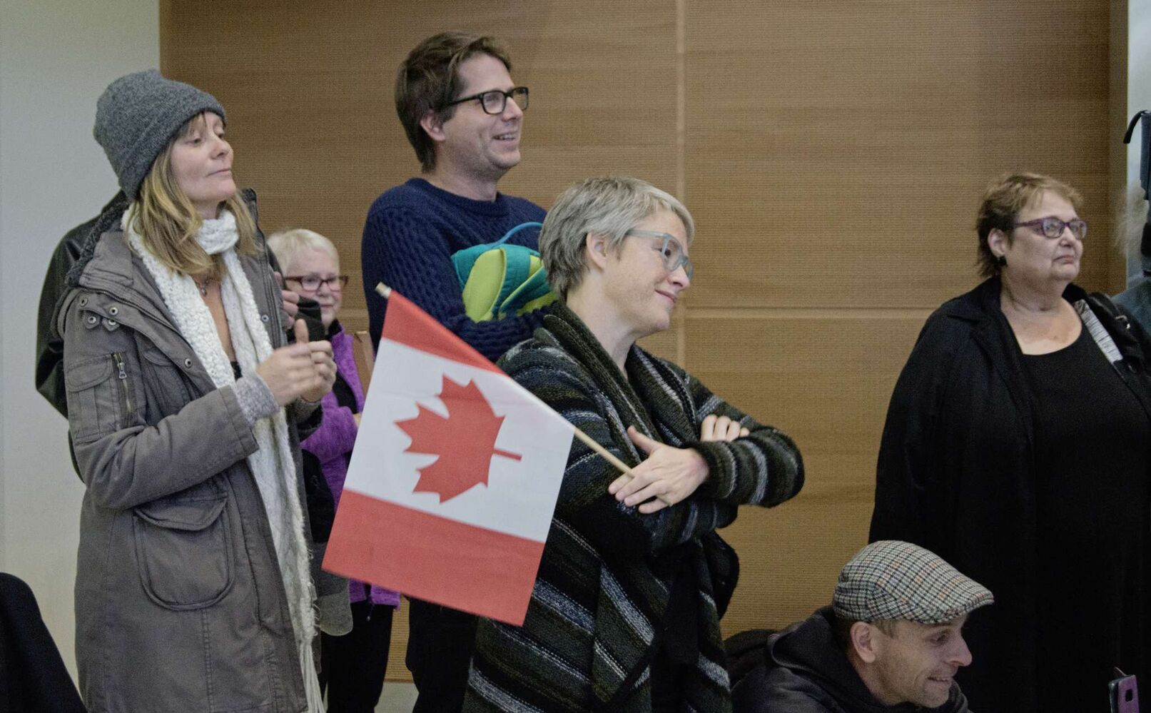 Sonya Jantz, Matthew Lawrence, and Paula Leslie watch as Al Abdellah is greeted by his aunt and uncle. (Danielle Da Silva - Sou'wester)