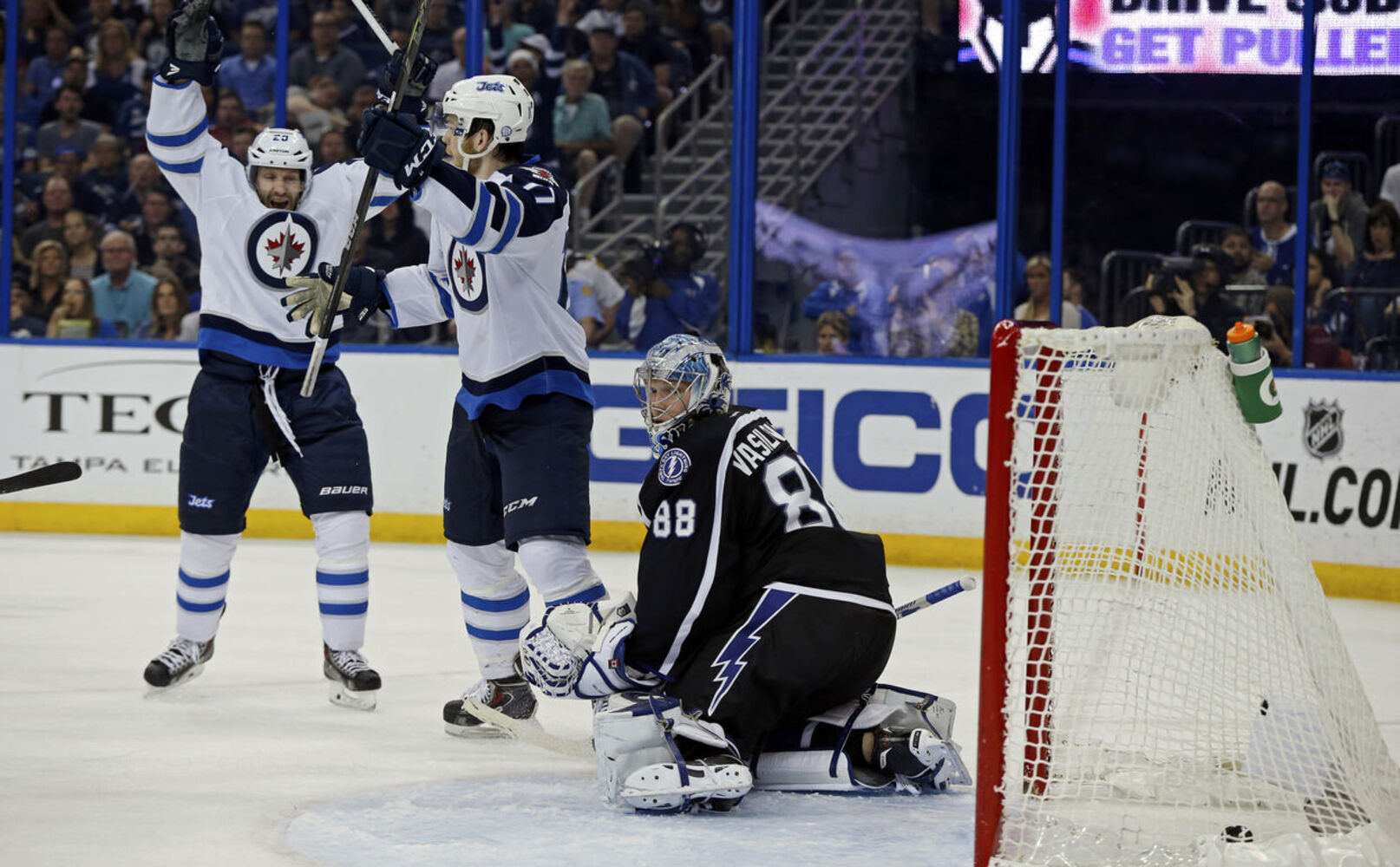 The Jets celebrate Drew Stafford's third-period goal. (Mike Carlson / The Associated Press)