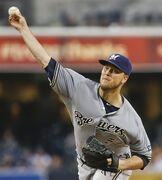 Milwaukee Brewers starting pitcher Jimmy Nelson pitches to the San Diego Padres in the first inning of a baseball game Tuesday, Aug. 26, 2014, in San Diego. (AP Photo/Lenny Ignelzi)