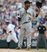 Pittsburgh Pirates starting pitcher Edinson Volquez, front, calls for new ball as Colorado Rockies' Brandon Barnes circles the bases after hitting a two-run home run in the fourth inning of a baseball game in Denver on Sunday, July 27, 2014. (AP Photo/David Zalubowski)