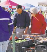 Shoppers and vendors mingle at St. Norbert Farmers' Market