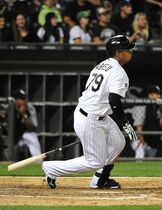Chicago White Sox's Jose Abreu watches an RBI single against the Minnesota Twins during the fourth inning of a baseball game, Friday, Aug. 1, 2014, in Chicago. (AP Photo/David Banks)