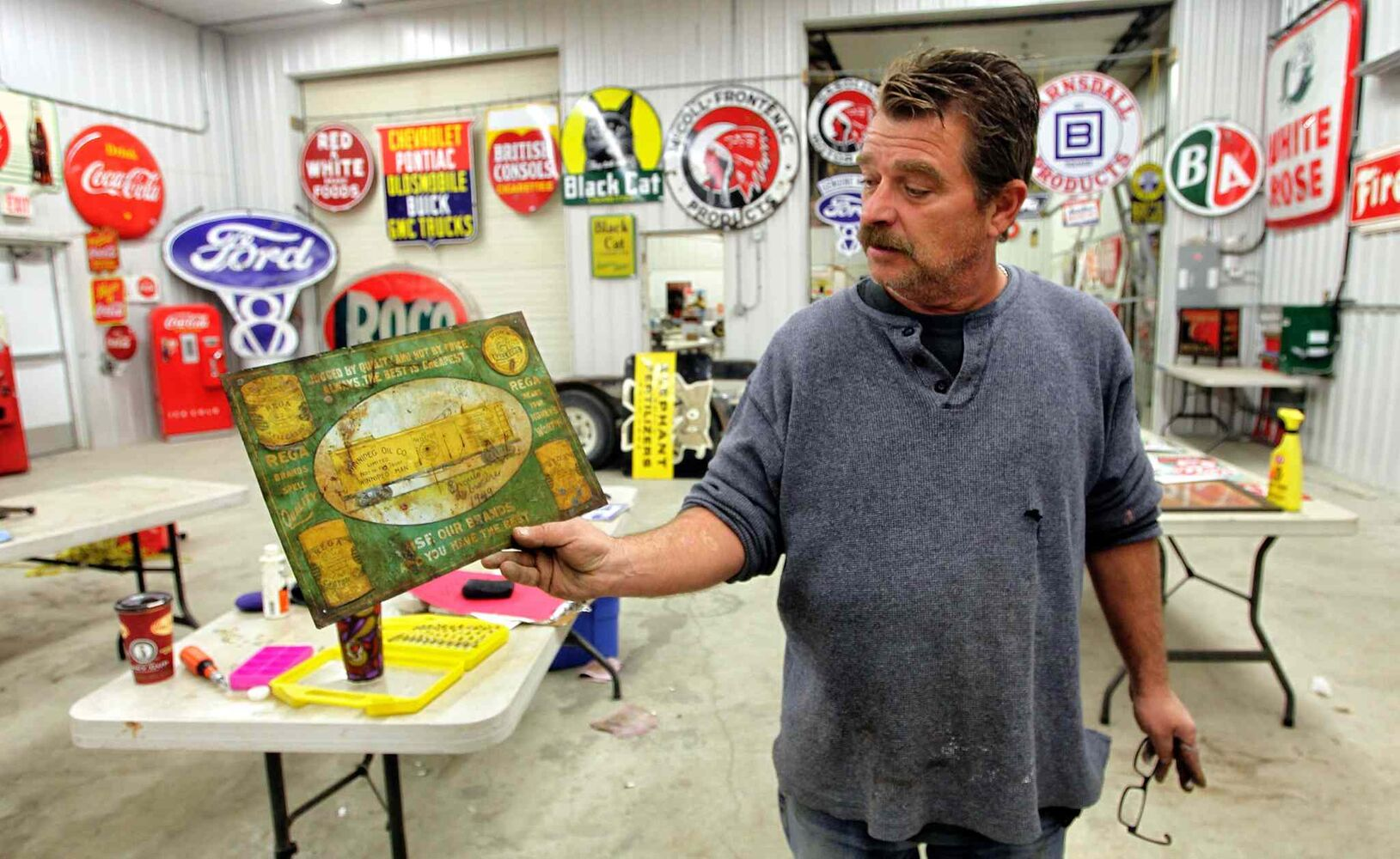 Bill Krasey gets some of the items ready for this weekend's auction in Stonewall, MB. (MIKE DEAL / WINNIPEG FREE PRESS)