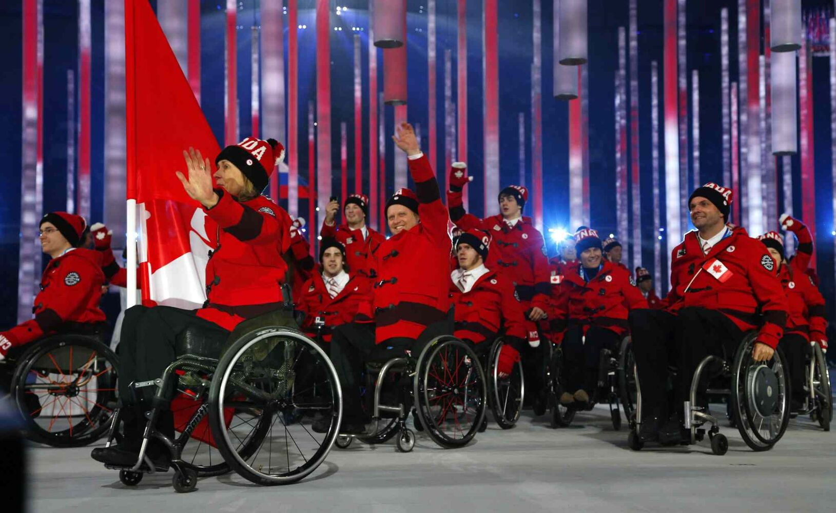 Athletes and officials of Canada enter the arena during attend the opening ceremony of the 2014 Winter Paralympics at the Fisht Olympic stadium in Sochi, Russia, Friday, March 7, 2014.  (Dmitry Lovetsky / The Associated Press)