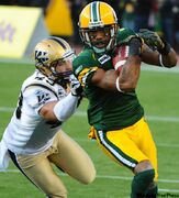 Winnipeg Blue Bombers' James Green (left) defends against Edmonton Eskimos' Jason Armstead at Commonwealth Stadium Saturday.