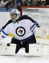 Winnipeg Jets goaltender Ondrej Pavelec makes a pad save during the first period of Wednesday's game.